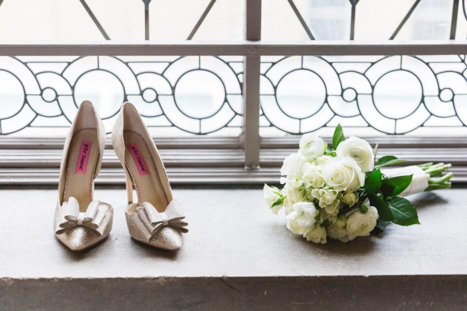 detail shot of bride's stilettos and white bouquet