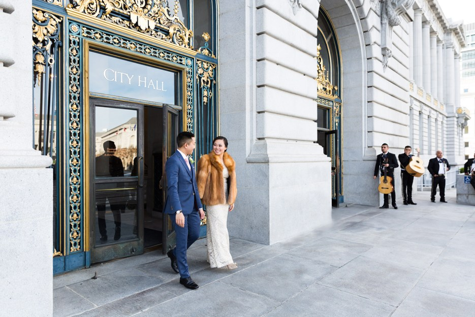 bride and groom depart from City Hall