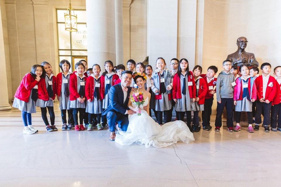 san francisco city hall wedding with large group of schoolchildren
