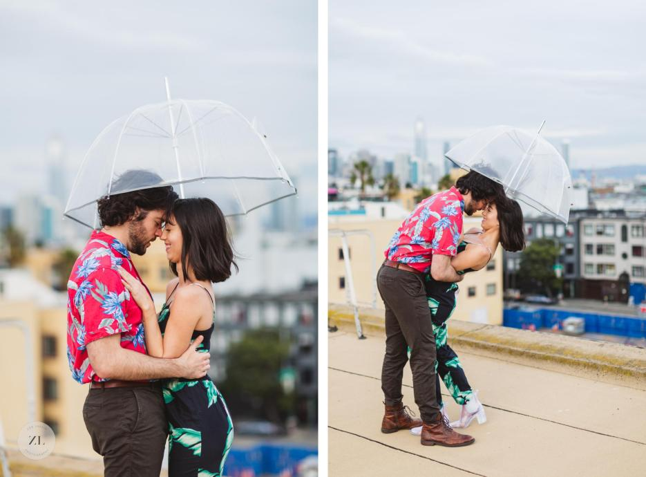 couple with umbrella dancing on rooftop