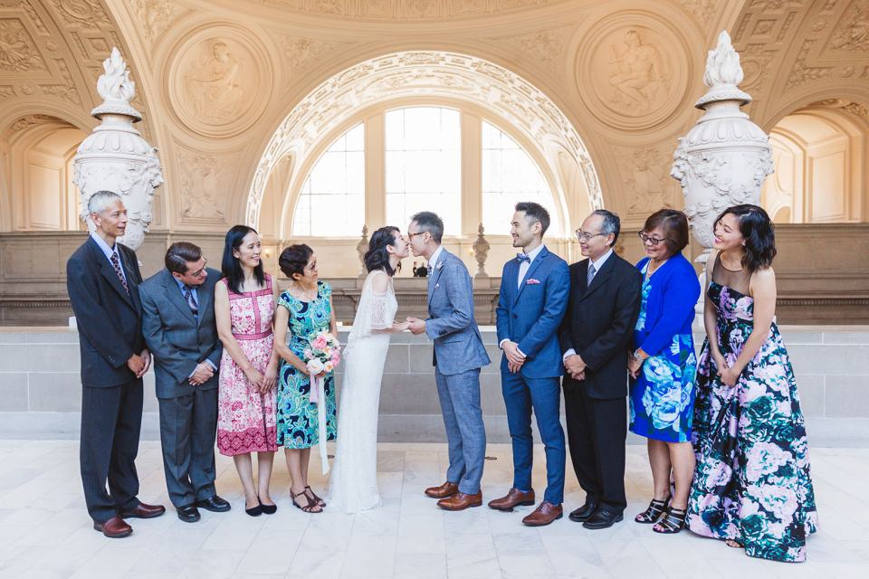 family posing on 4th floor right before wedding ceremony