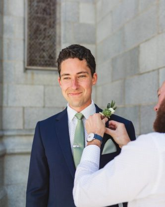 san francisco groom boutonniere pinning outside church to understand crop ratio