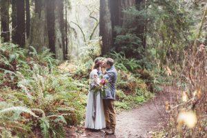 couple kissing at forest of nisene marks wedding in santa cruz redwoods