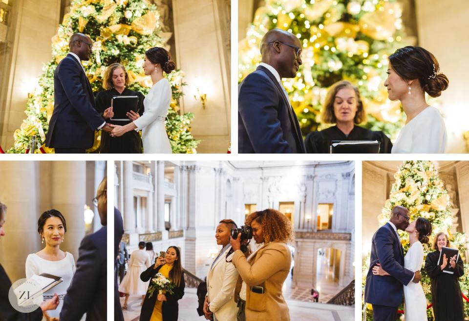 christmas city hall rotunda wedding ceremony with relaxed couple getting married