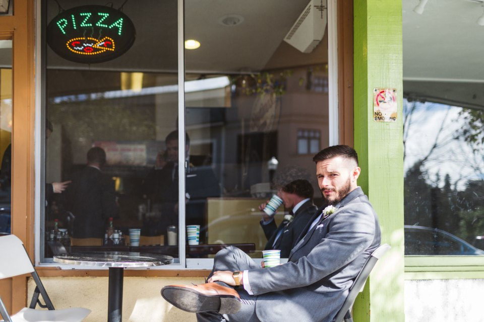 marin county wedding photography groomsman outside pizza place