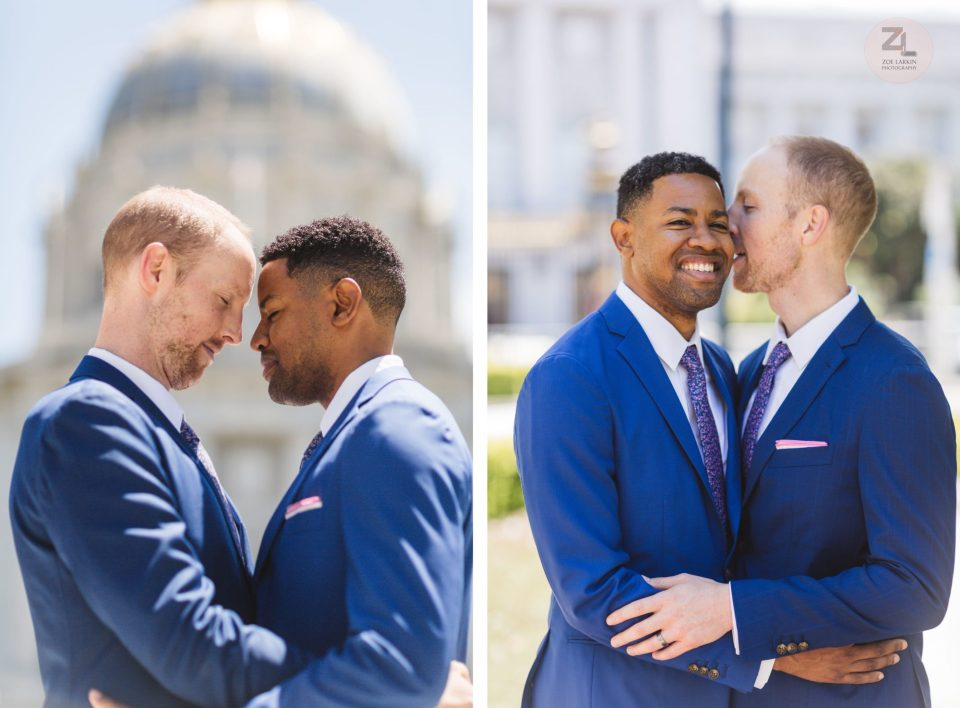 interracial gay couple posing on wedding day at back of sf city hall