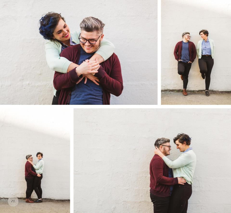 hip queer couple engagement with white wall in background