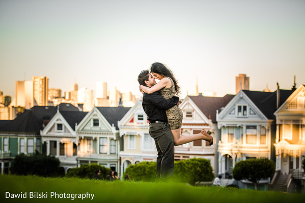 painted ladies engagement shoot with couple kissing - great portrait location near City Hall