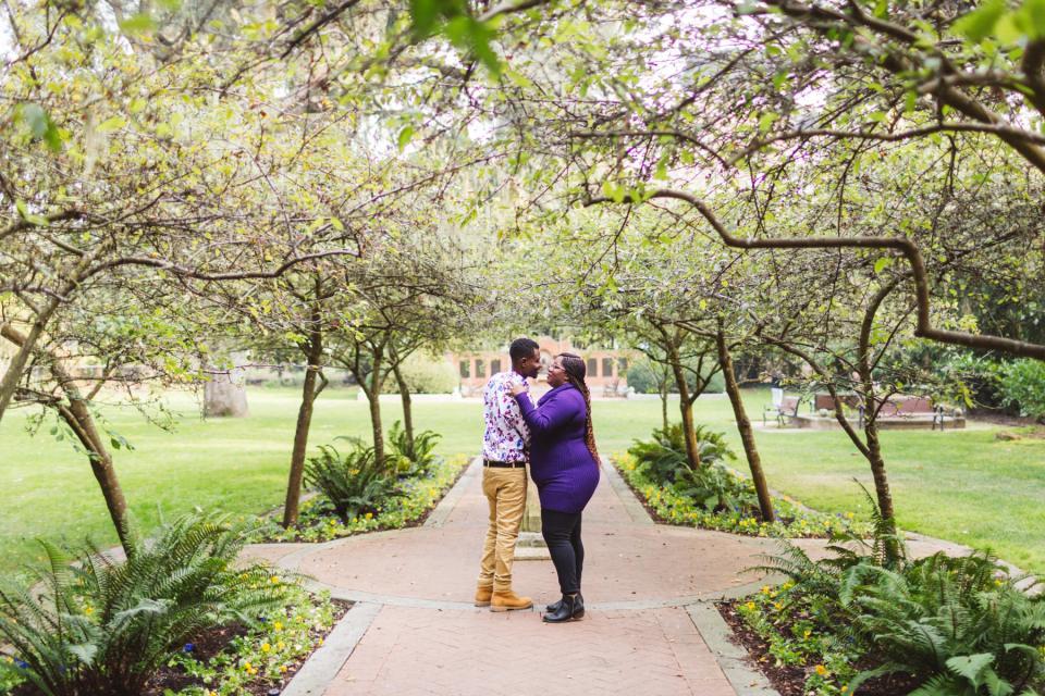 couple getting their engagement photos shakespeare Garden, Golden Gate park SF