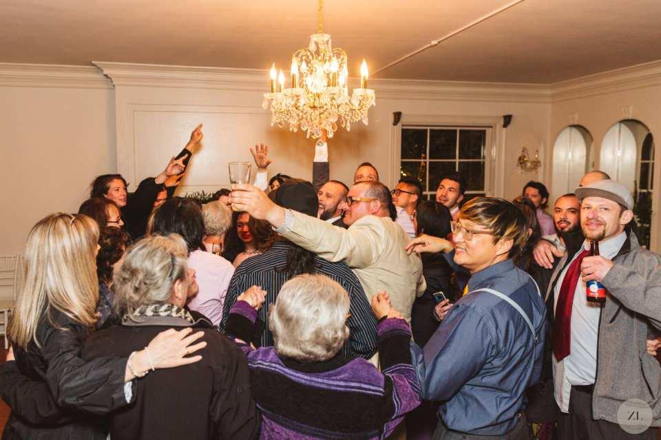 dancefloor hug at wedding by Zoe Larkin Photography