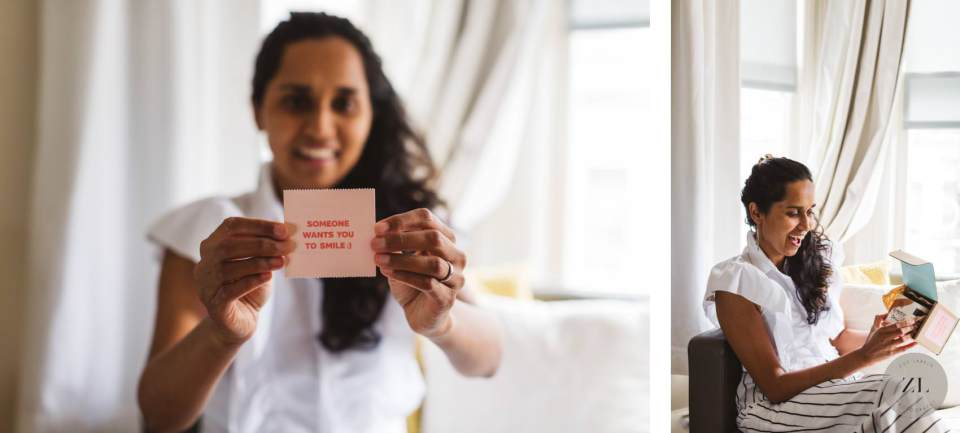 Holding up the Greetabl message - someone wants you to smile inside the gift box