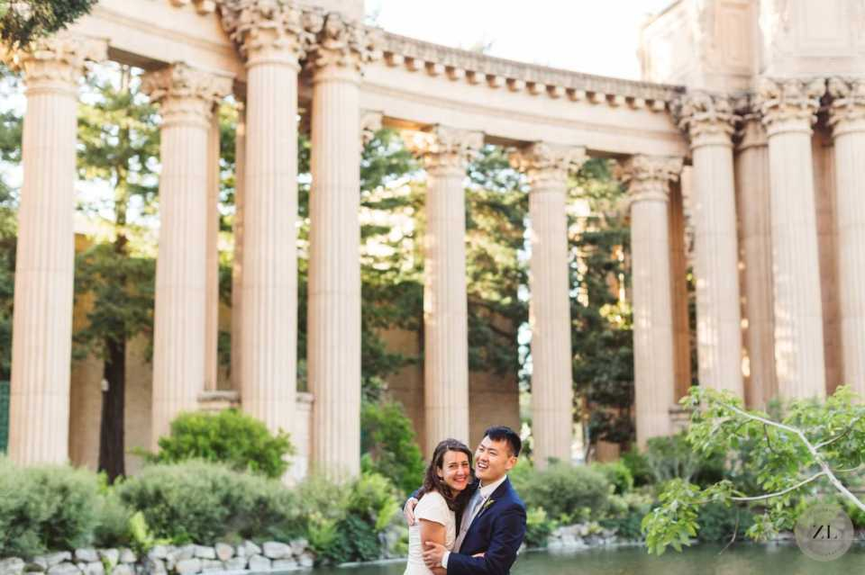 wedding couple laughing with the columns on palace of fine arts in the background