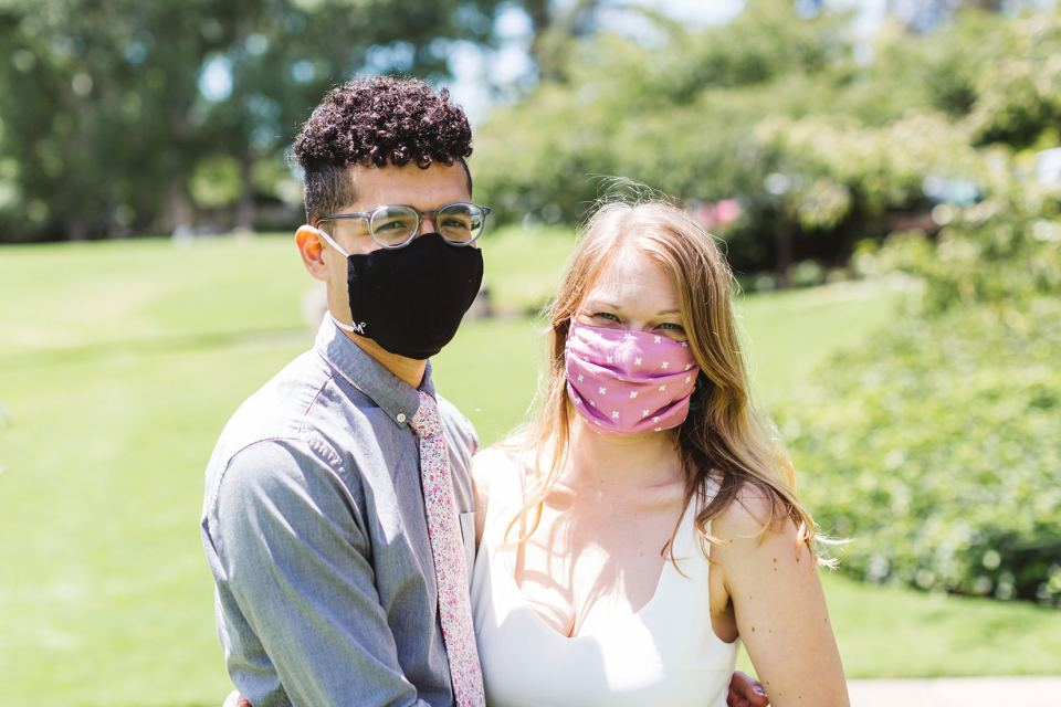 couple wearing their masks at their wedding for covid wedding planning tips