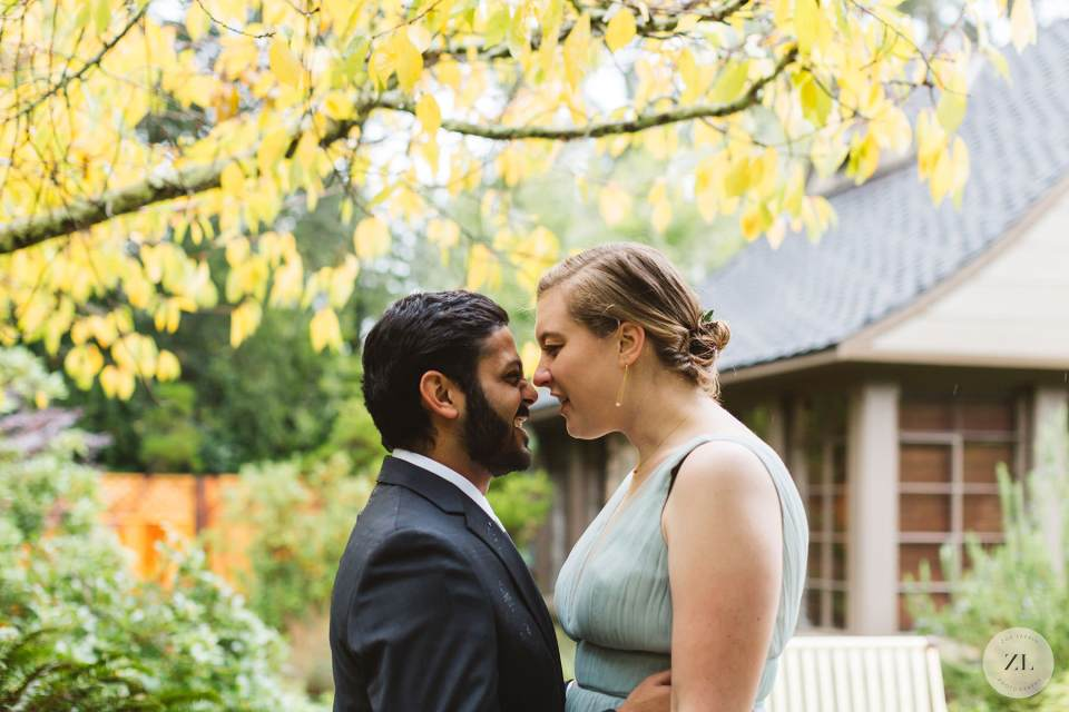 couple kissing outside the Brazilian room, tilden park in Berkeley CA after suffering a power outage and rain on their wedding day!