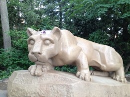 Mr. Shoe atop the head of the PSU mascot, the Nittany Lion
