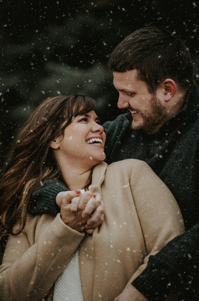 smiling at each other in the snow