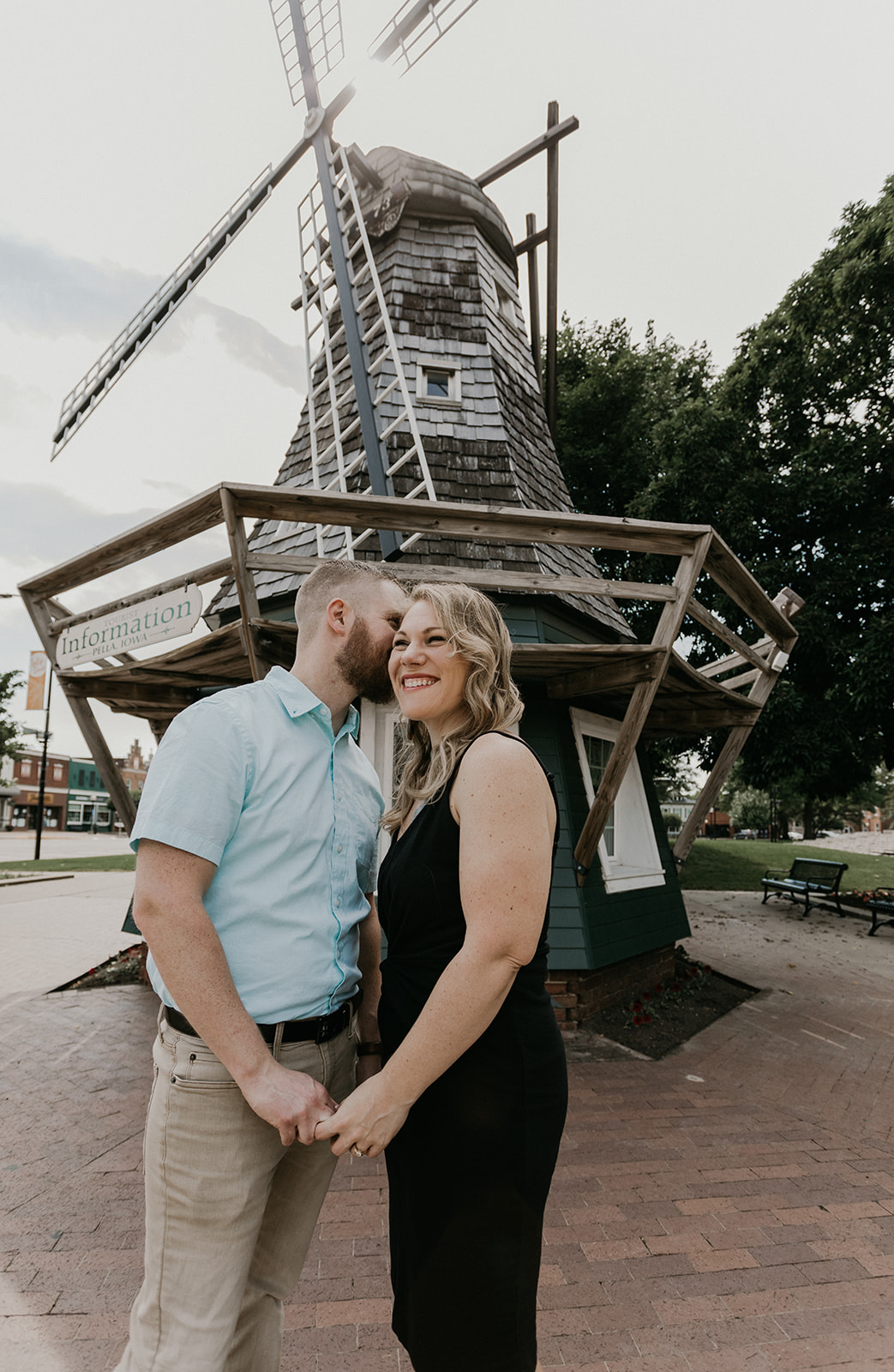 spring engagement session in downtown pella with giant windmill