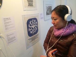 Una Chung listening to the music of the Asian American movement