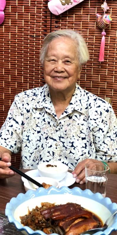 Lam Cheung-tai enjoying her meal