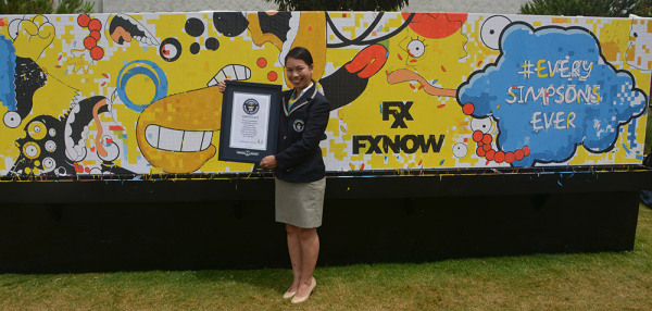 Guinness adjudicator awards the world record by SDCC mural. (Courtesy of FXX)