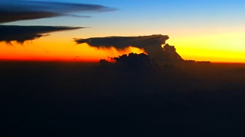 Sunset and strange cloud formation at 30,000 feet in the air