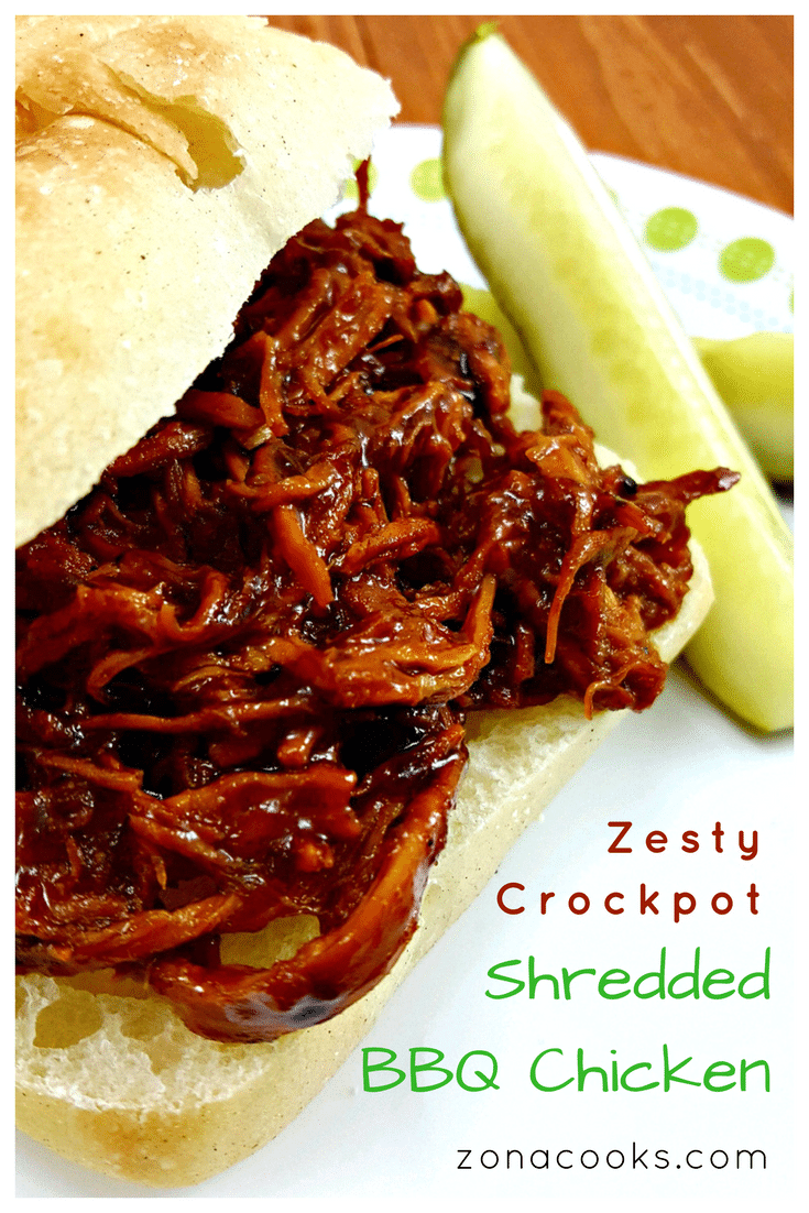 Zesty Crockpot Shredded BBQ Chicken - Zesty Crockpot Shredded BBQ Chicken is a great twist on basic barbecue chicken. It's as easy as adding frozen boneless chicken to your slow cooker, topping it with the sauce ingredients, then set it and forget it! We served it on a deli Ciabatta roll and a dill pickle spear, tortilla chips and this homemade Tomato Peach Salsa. This would also work well with beef or pork.