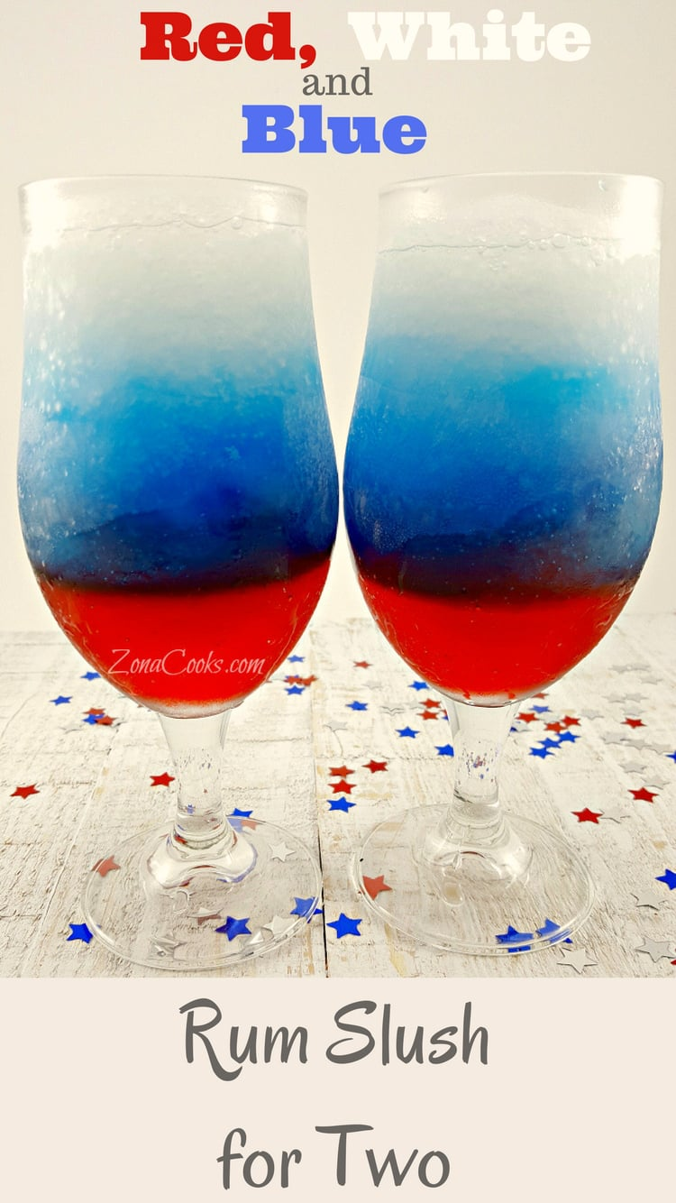 Red, White and Blue Rum Slush for Two - How will you celebrate your patriotism? How about with this refreshing and colorful frozen slush drink made with Grenadine, Blue Curacao, and Rum spiked lemonade. This is the perfect treat for two on a hot summer day or night
