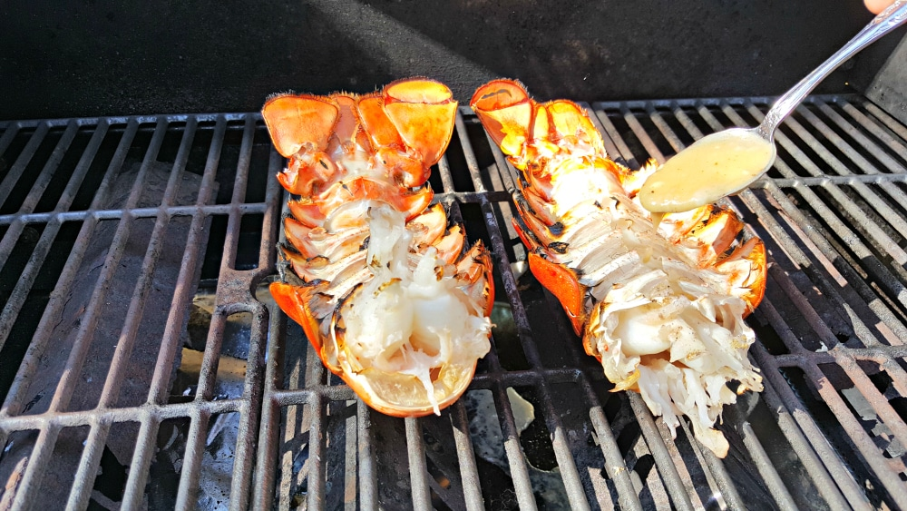 Grilled Lobster Tails Recipe for Two - flip over and drizzle on some butter mixture