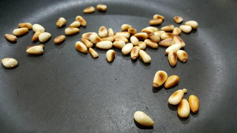 Mushroom Parmesan Ravioli Recipe - toast the pine nuts in a dry frying pan