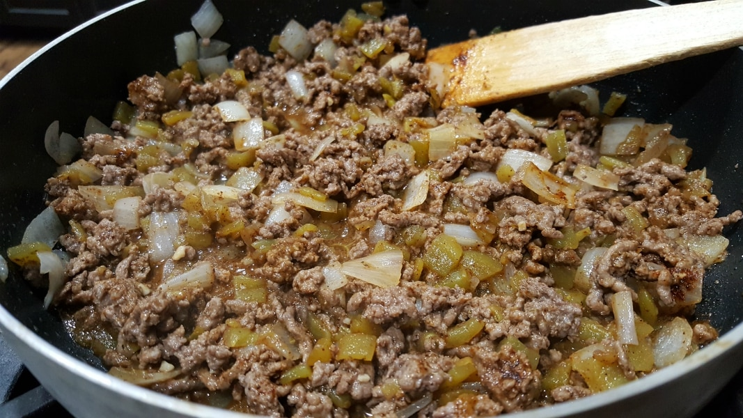 Individual Mexican Casseroles Recipe - brown ground beef with onion, garlic, green chiles, and seasonings