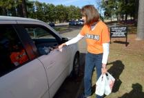 Zonta Club member Carol Manley collects donated items Saturday during the Gifts of Giving fundraiser at a drop-off point. (Kevin Green/Longview News-Journal)