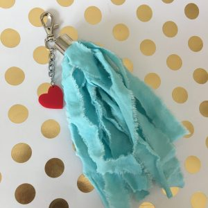 aqua tassel bag tag with red heart charm