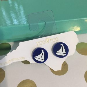 blue earrings with white sailboat