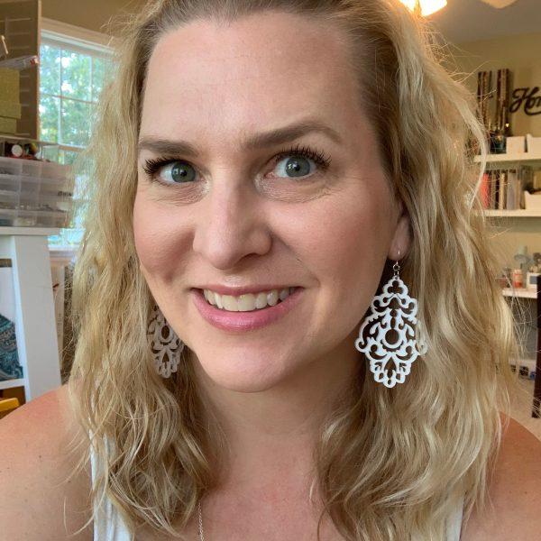 white chandelier earrings on model