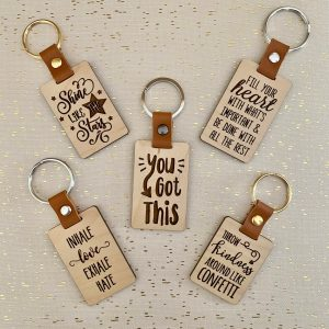 wood and leather quote keychains