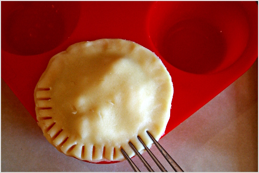 mini apple pies recipe with step by step pictures, ingredients, Thanksgiving pies, Thanksgiving recipe, Holiday recipes, put dough circle on top of mini pie, with your finger, press the edges gently, using a fork, create some nice ornament