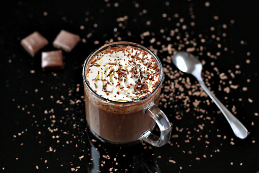 homemade hot chocolate recipe with step by step pictures, pour the chocolate into two cups and garnish with a dollop of whipped cream and some grated chocolate or a dusting of cocoa powder