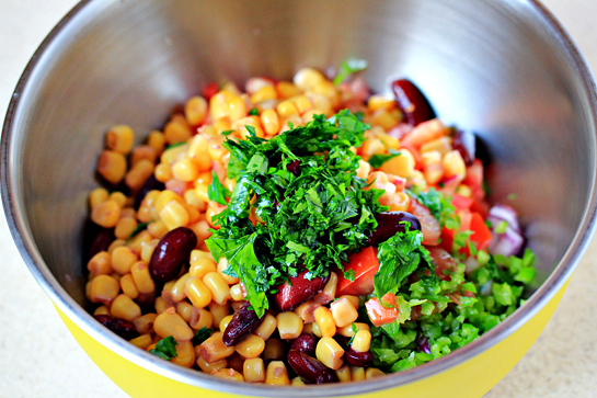 chicken burritos recipe with step by step picture instructions, place it all in a bowl, add the finely chopped parsley cilantro, add 1/3 teaspoon salt, mix to combine