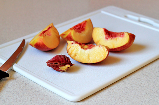 roasted summer fruit with rosemary and cream recipe with step by step pictures, remove the pit and then cut each half in half again