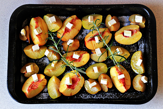 roasted summer fruit with rosemary and cream recipe with step by step pictures, sprinkle fruit with sugar, you can use more sugar if your fruit is slightly under-ripe, cube the butter and distribute it over the fruit, add the rosemary sprigs