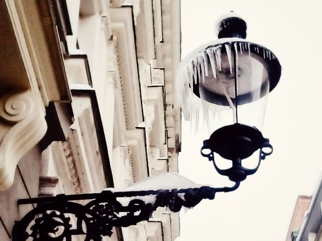 a walk in city centel old street lamp with icicles