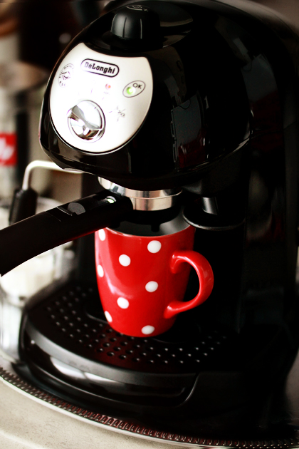 making coffee red mug with polka dots
