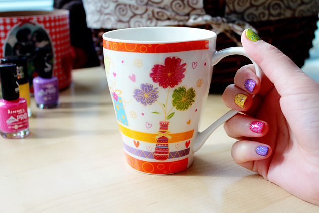 colorful mugs with flowers and nails painted with different colors
