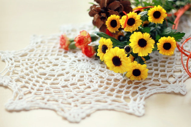 flowers on crochet doily
