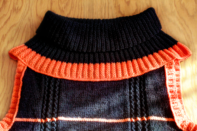 black and orange long knitted vest neck detail