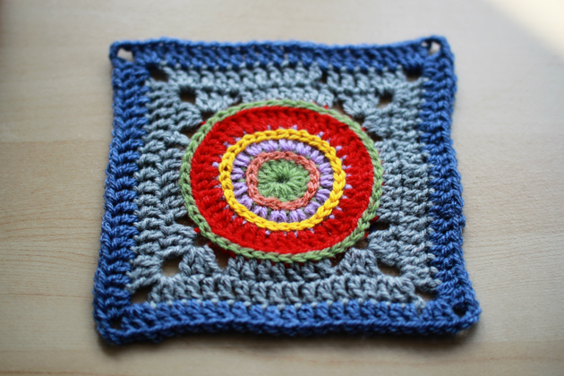 granny square with colorful circle in the middle