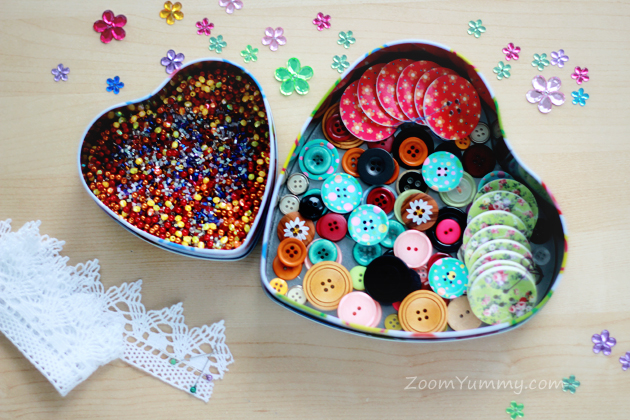 heart shaped boxes filled with beads and buttons