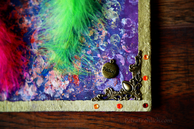 colorful-feather-on-a-painting