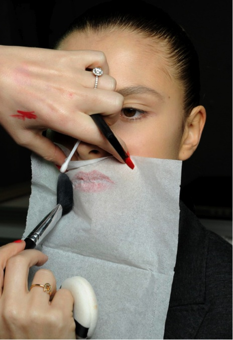 Apply Translucent Powder Over The Tissue For Long-Lasting Lipstick