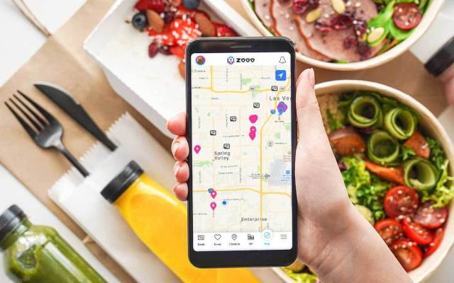 A mobile app shows a map with location markers pinned over local businesses.